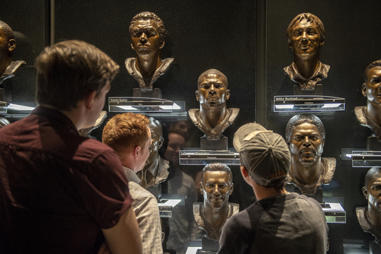 Students looking at busts
