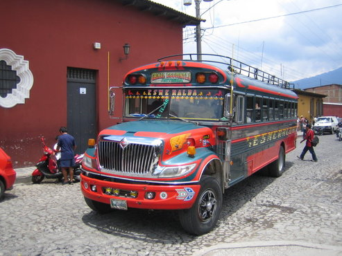 "Google image of a typical ""chicken bus,"" former US school buses that are a common form of public transportation through mountainous terrain and the outback in Central America."