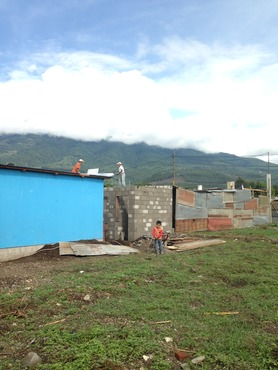 Another ConstruCasa construction site in San Miguel Duenas, with single volunteer builders, and a good view of the nearby volcano.