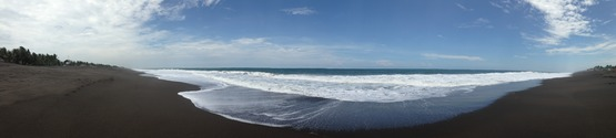 Panoramic view of the oceanfront in Monterrico, Guatemala, known for its volcanic black sand beaches, and popular with vacationers from Guatemala City.