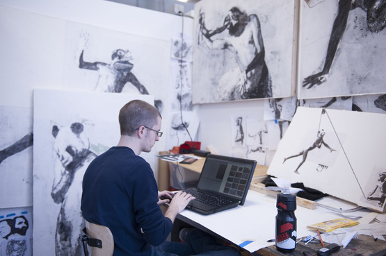 A student on his laptop in his studio