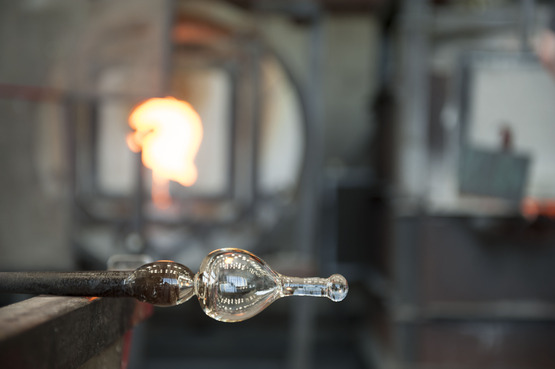 Image of a Glass bottle being made in the Hot Shop