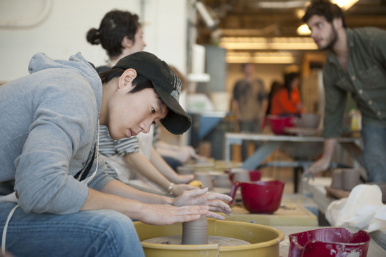 Students working at the potter's wheel
