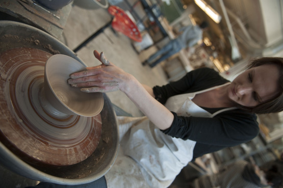 A student working at the potter's wheel