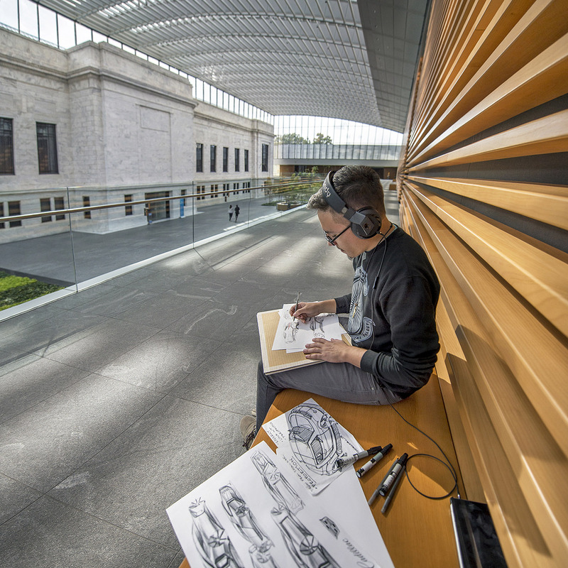 A student sketching cars in the Cleveland Museum of Art