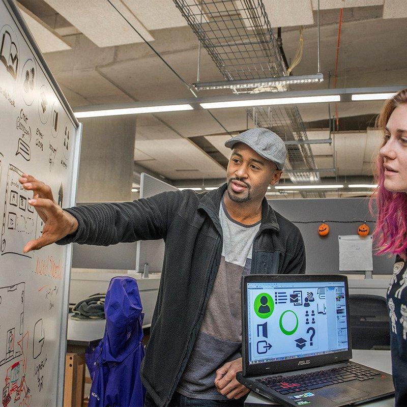 A professor explaining a concept to a student