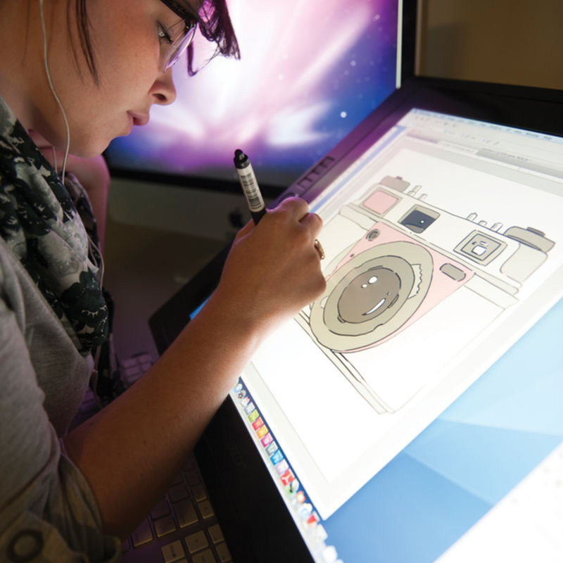 A student working on a project on a cintiq