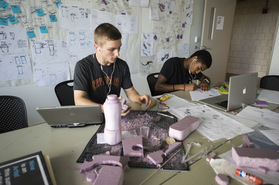 Students in the Industrial Design class working on their mock ups.