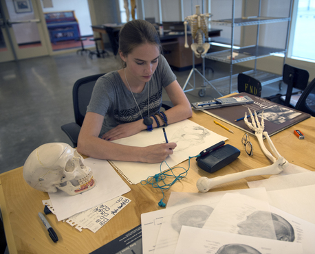 A student drawing in the Biomedical Art studios.