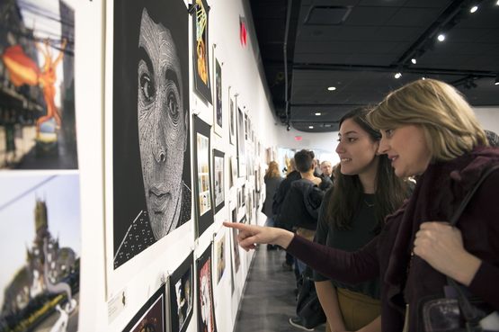 Families view artwork in the Scholastic Art and Writing exhibition.