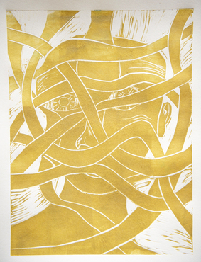 An abstract print in gold ink created by a student.
