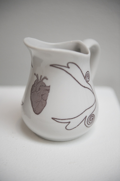 A ceramic vessel with glazed drawings created by a Pre-College student.