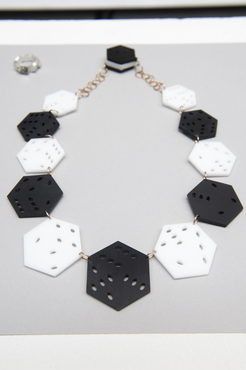 A 3D printed necklace with hexagon shapes.