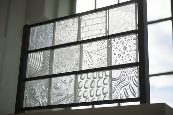 Clear textured glass arranged in a panel format.