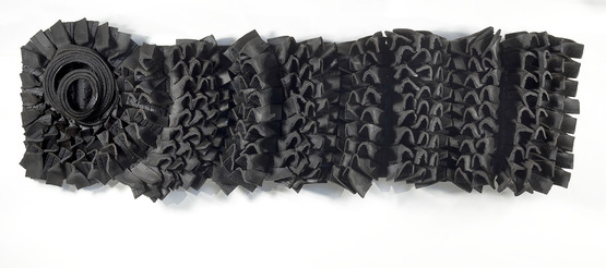 <strong>  Handle With Care</strong><br />Chakaia  Booker, 2010<br />rubber tires and wood, 34 1/2 x 98 x 11 inches