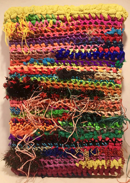 crotchet work using many colored yarns, beads, and raffia