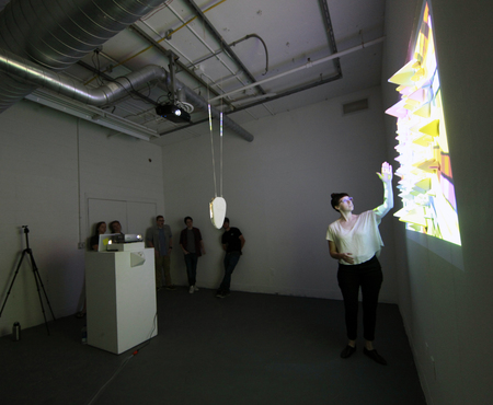 Students test an experimental projection and installation.