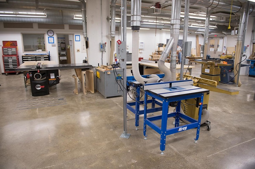 Table saws and routers in the CIA wood shop.
