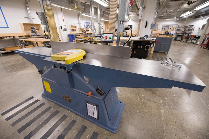 The wood shop has three joiners, one of which has 16-inch capacity.
