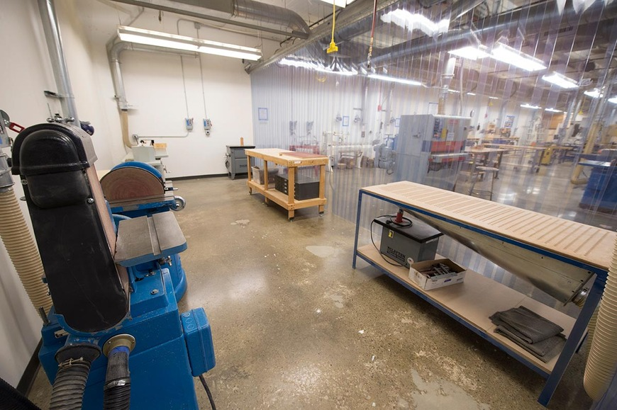 The wood shop sanding booth includes a combination sander, disc sander, down draft table and a spindle sander.