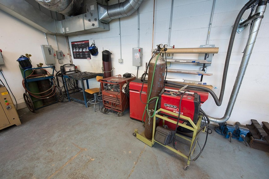 The metal shop equipment includes torches, a plasma cutter, and TIG welder.