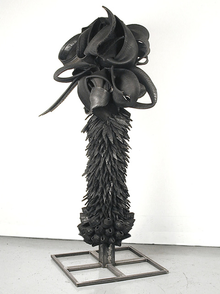 <strong>Cross Over Effects</strong><br />Chakaia Booker, 2003<br />rubber tires and wood, 81 x 39 x 36 inches