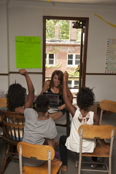 <strong>Here a student is shown teaching art at a local Freedom School.</strong><br />