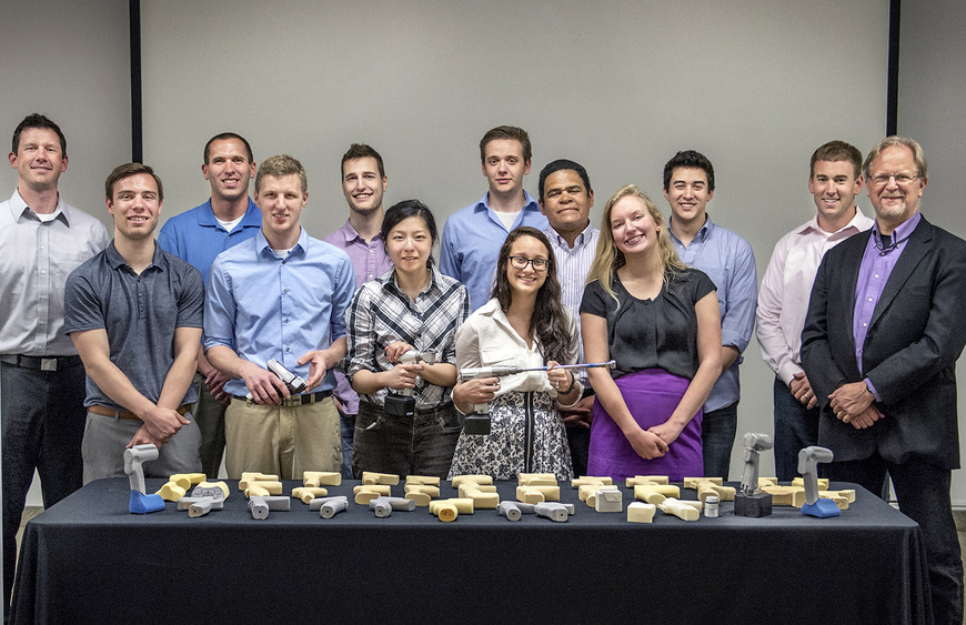 The Stryker project team with a few of their prototypes. From left: Steve Clifford (Stryker), Adam Valco '15, Jim Beachneau (Stryker), Kevin Zehe '14, Alex Price '15, Geemay Chia '15, Cameron Lada '15, Katelyn Petronick '15, Jose Calderon (Stryker), Caitlyn Moss '16, Duke Matelski '15, Aaron Johnson (Stryker), and Associate Professor Douglas Paige '82.