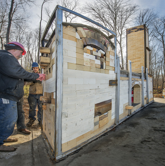 <strong>Students and their professors build a wood-fire kiln off-site at a CIA outdoor satellite location.</strong><br />