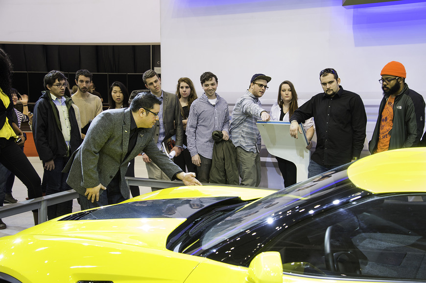 <strong>Students visit the auto show, where a CIA alumni discusses the car he helped design.</strong><br />