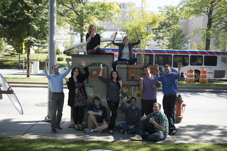 <strong>Students surround one of the many utility boxes they beautified, as consultants for University Circl</strong><br />