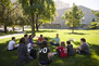 A class enjoying an outdoor discussion at one of the many park-like settings in the immediate campus vicinity.