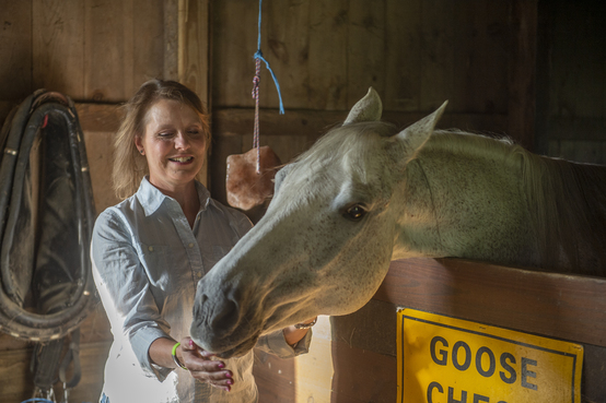 Faculty member Beth Halasz with her quarter horse