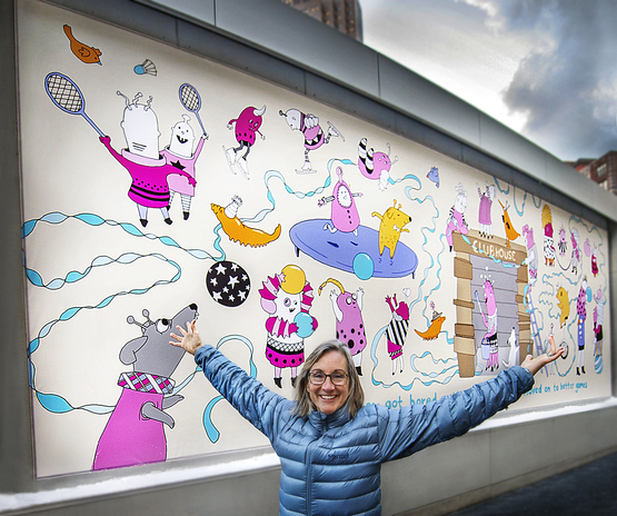 photo of Karen Sandstrom with mural