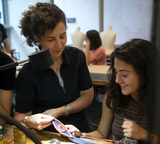 Pamela Argentieri reviews student's accessory design in the jewelry studio