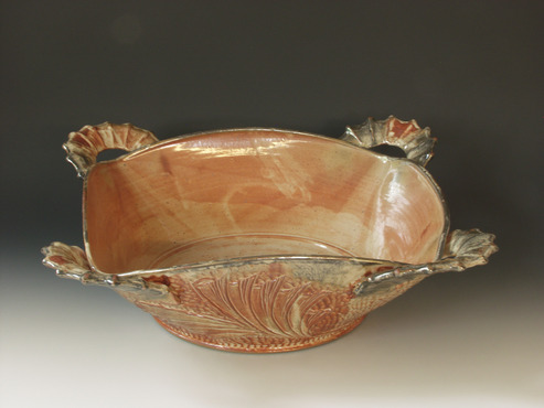 <strong>&quot;Table Presentation Bowl&quot;</strong><br />William  Brouillard, 2009<br />Stoneware clay fired to cone 10 reduction, wheel thrown with carved handles