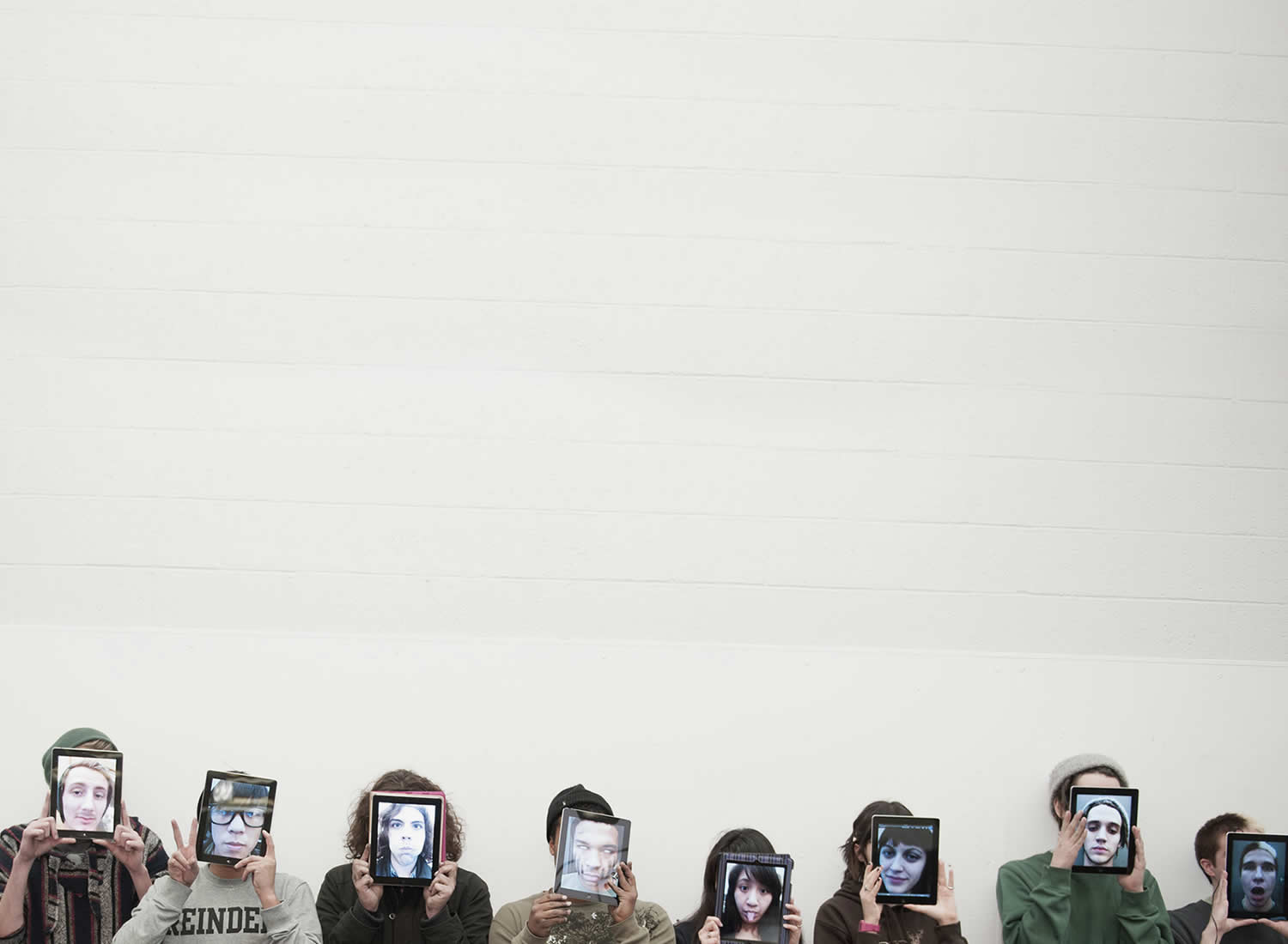 Students with iPad faces